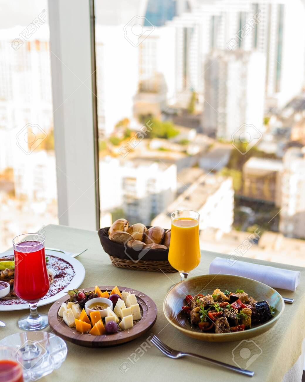 Tasty meals, cheese mix, fruit juice on the restaurant table - 150763083