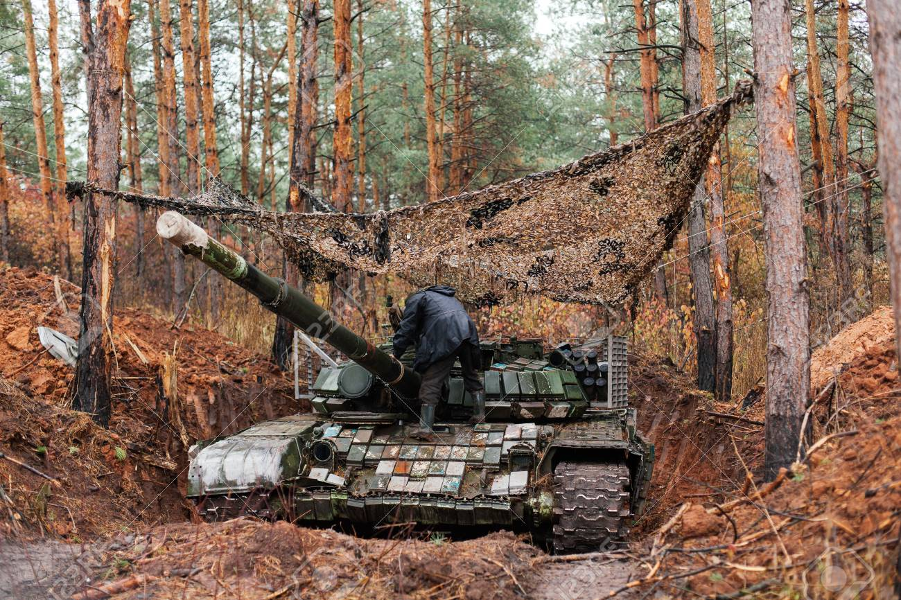real battle tanks disguised in the trenches donbass ukraine stock