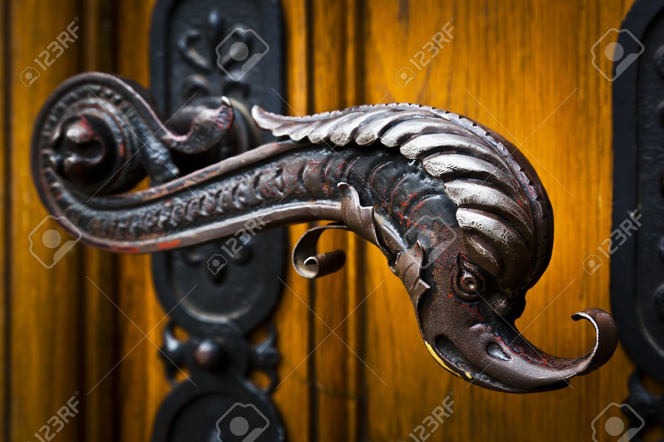 Decorative antique door handles with fish pattern on a big chatedral Stock  Photo - 15731450 - Decorative Antique Door Handles With Fish Pattern On A Big Chatedral