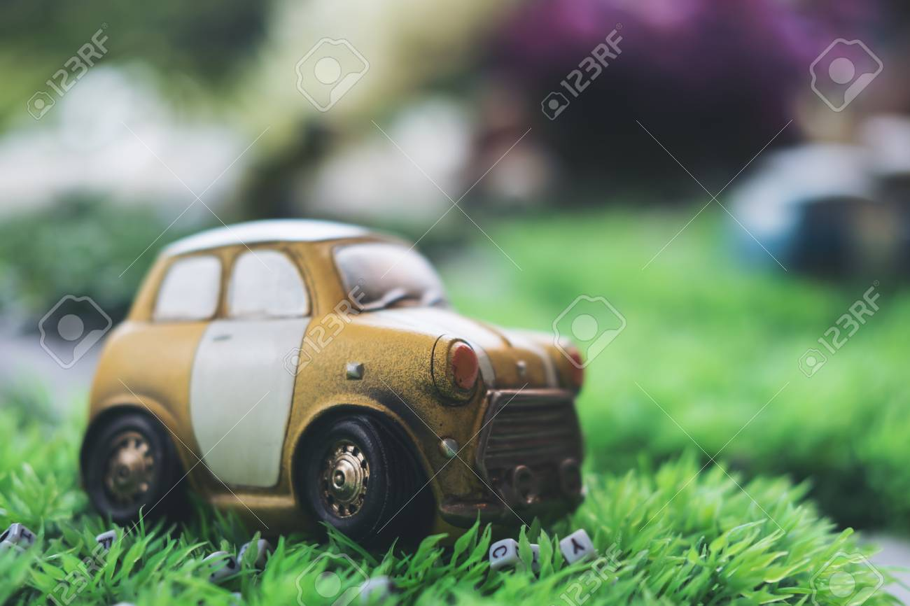 Closeup Image Of Small Vintage Cars Model On Green Grass Stock Photo ...
