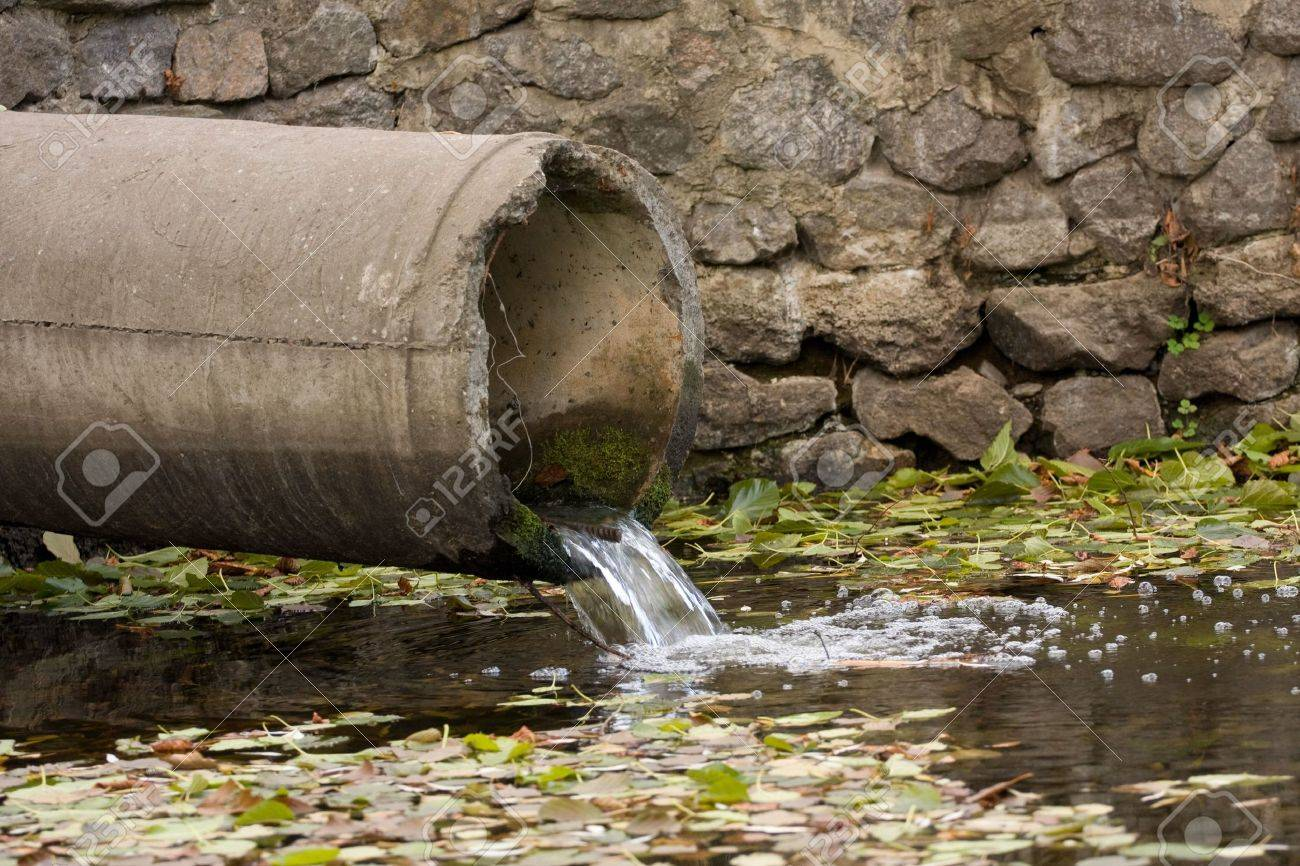 sewage pipe polluting the river - 5810155