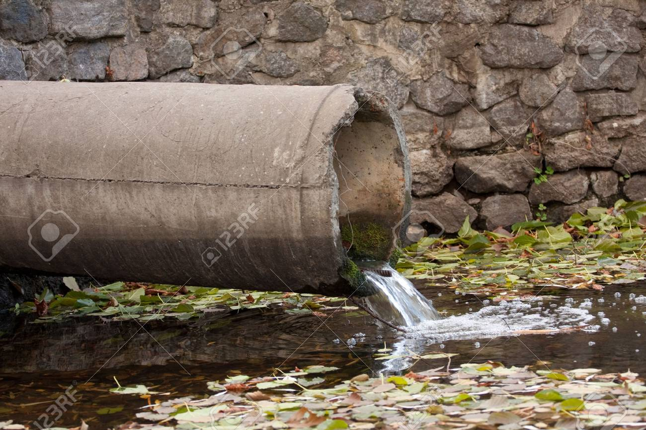 sewage pipe polluting the river - 6482621