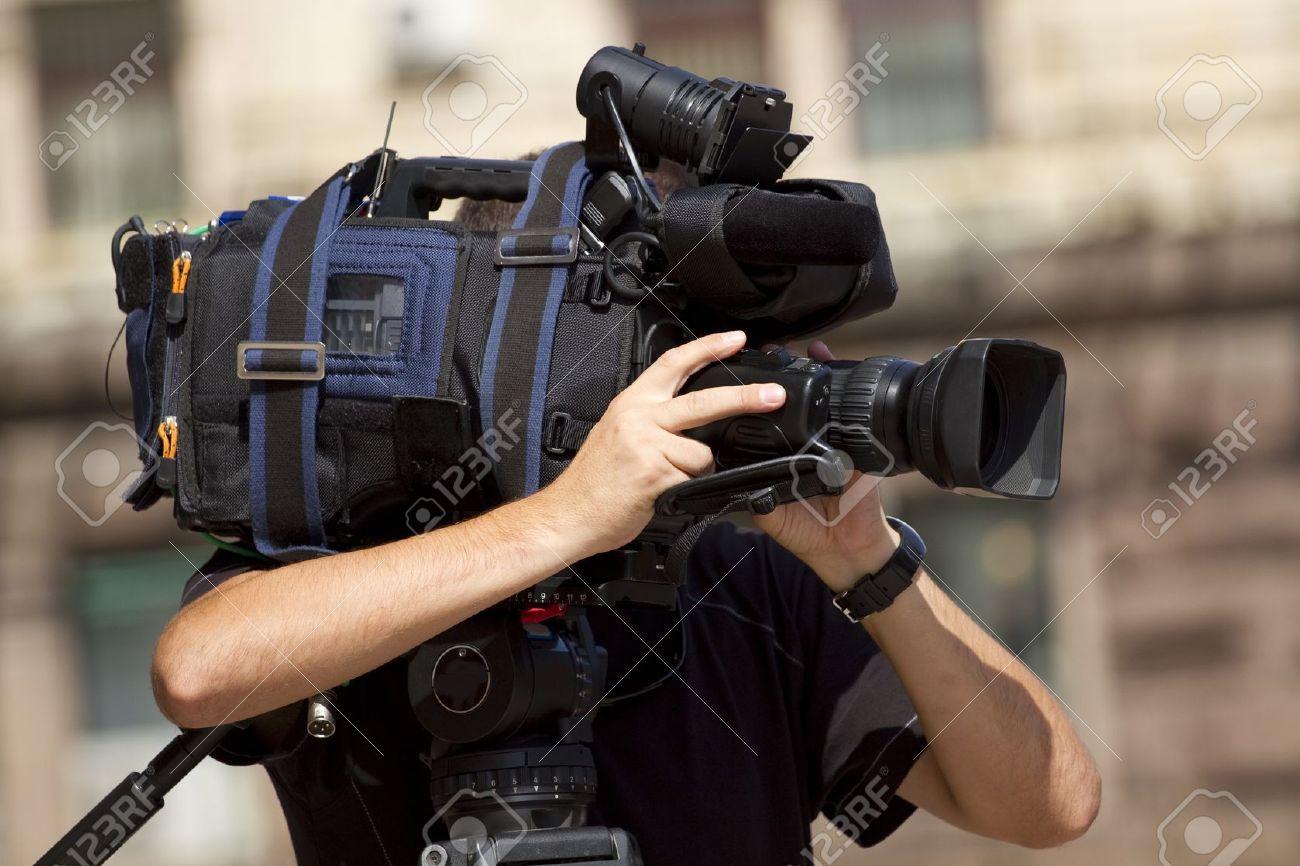 Cameraman working in the street - 7775796