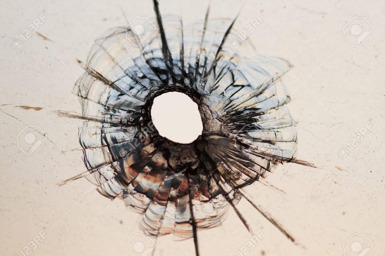 bullet hole in window - background - 9491241