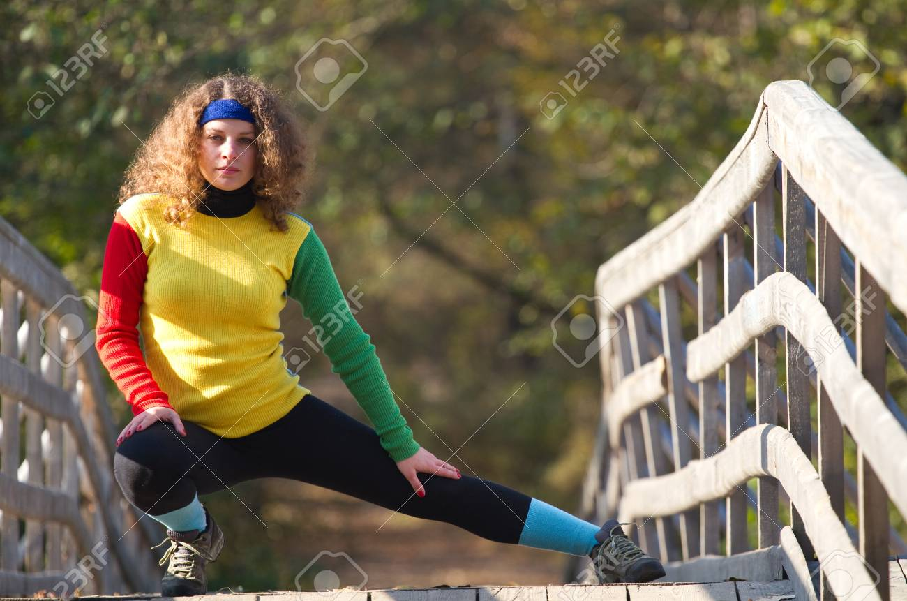 Beautiful girl doing stretching exercise Stock Photo - 11090402