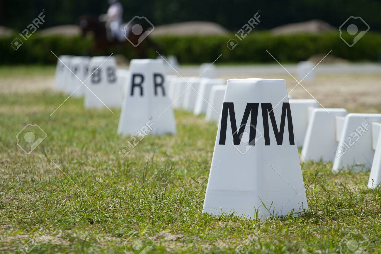 horse dressage arena letter post and field fence stock photo 26163827