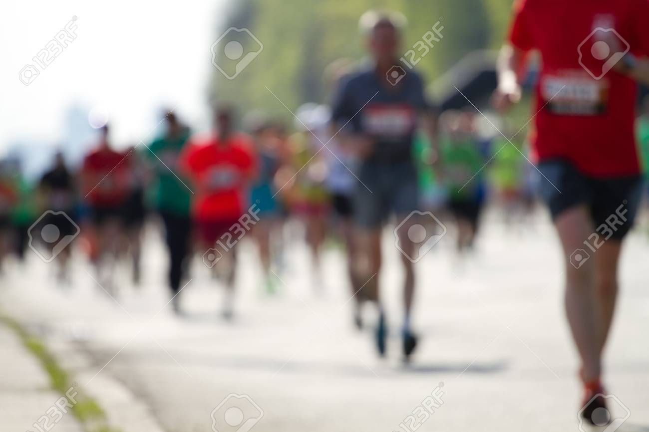 Blurred mass of marathon runners - 39564404