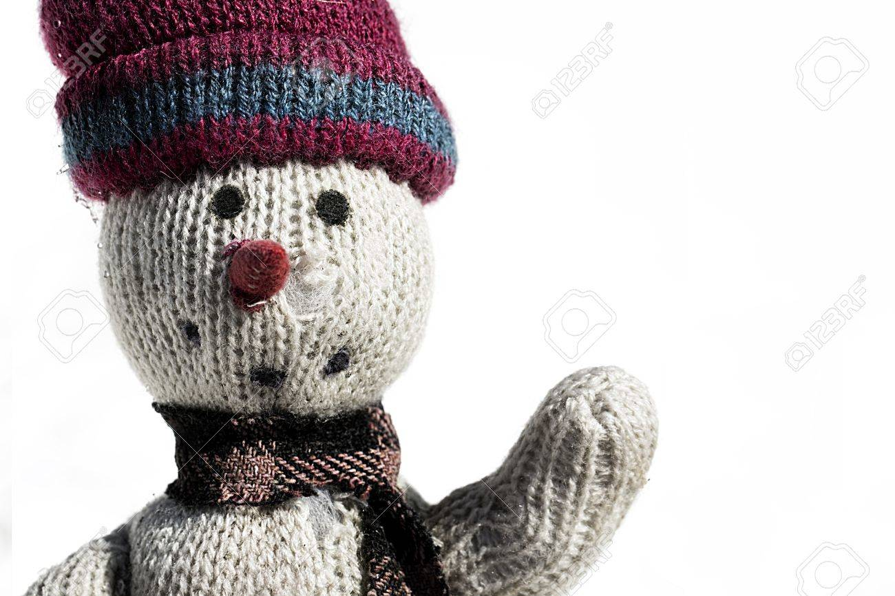 old rag doll in the snow with a red heart on white background Stock Photo - 18561105