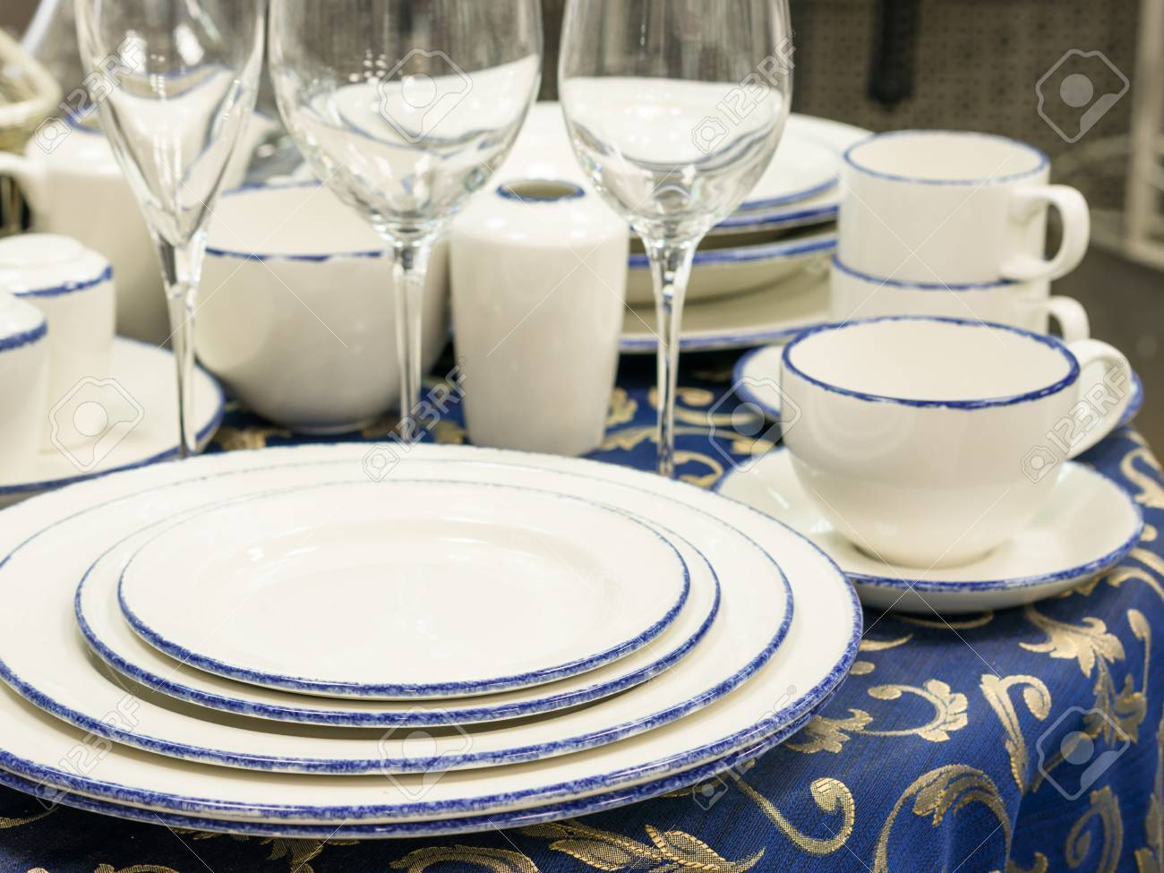 Set of dishes close up on table with blue tablecloth. Stack of plates wine & Set Of Dishes Close Up On Table With Blue Tablecloth. Stack Of ...