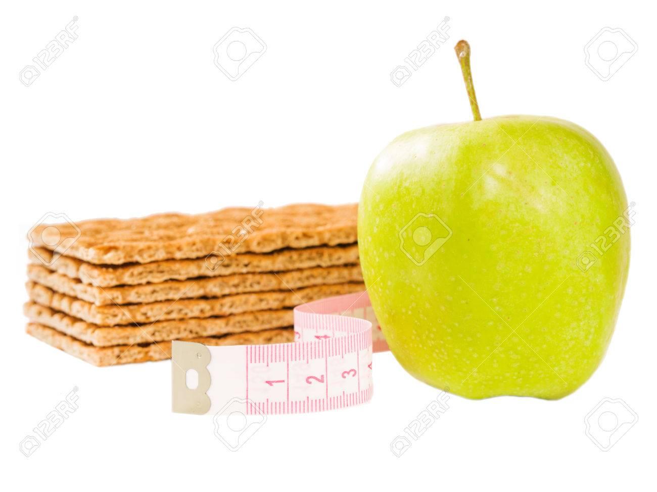 Massband Knackebrot Und Kostlichen Grunen Apfel Isoliert Auf Weiss