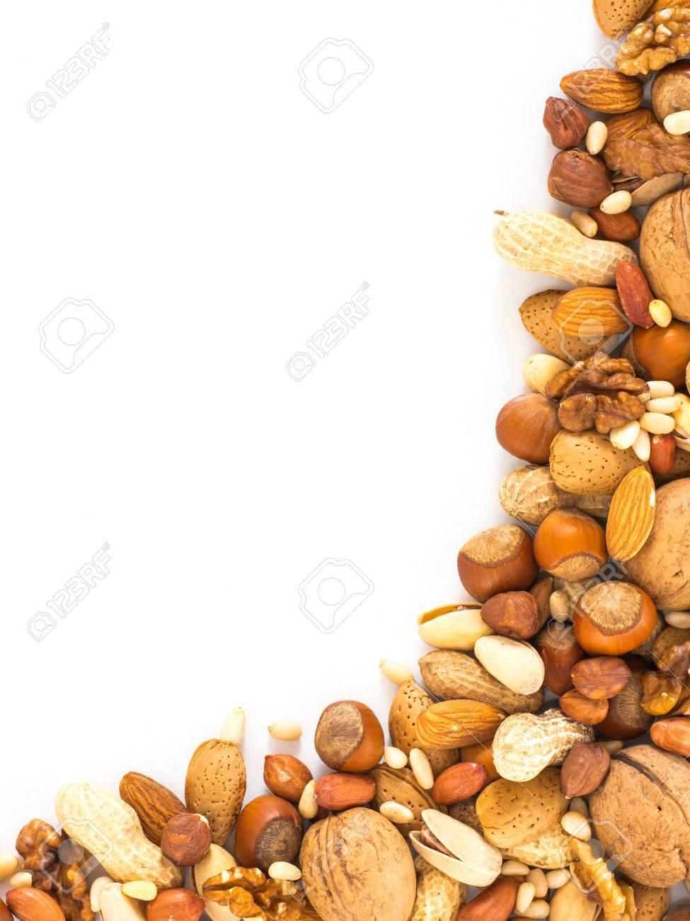 Background of mixed nuts - hazelnuts, almonds, walnuts, pistachios,