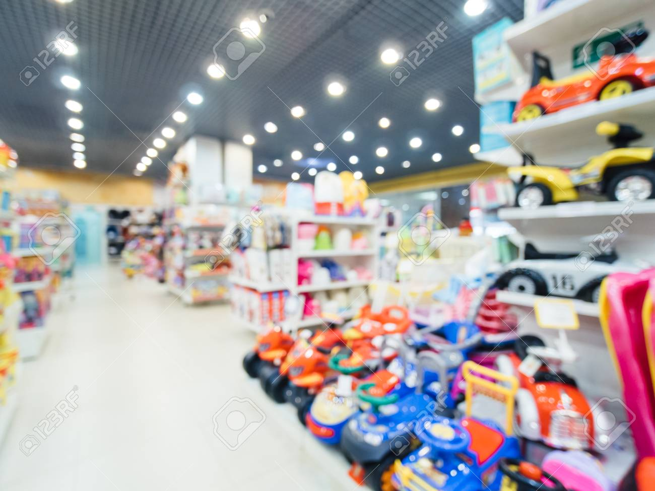 Blurred Of Kids Toy Store Background With Bokhe Shelves And Stock