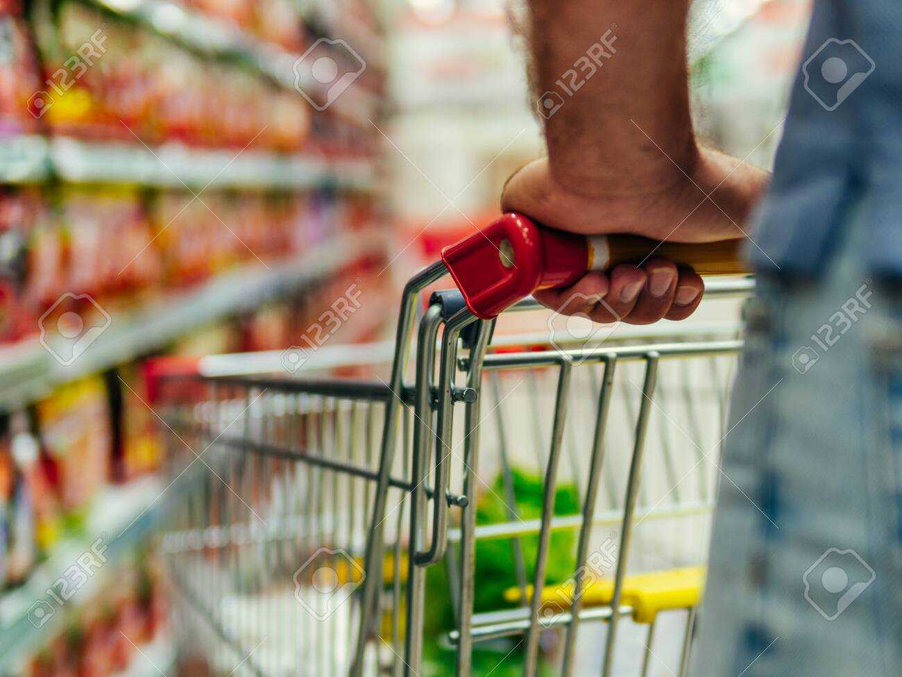 shopping trolley in supermarket aisle, copy space - 125413228