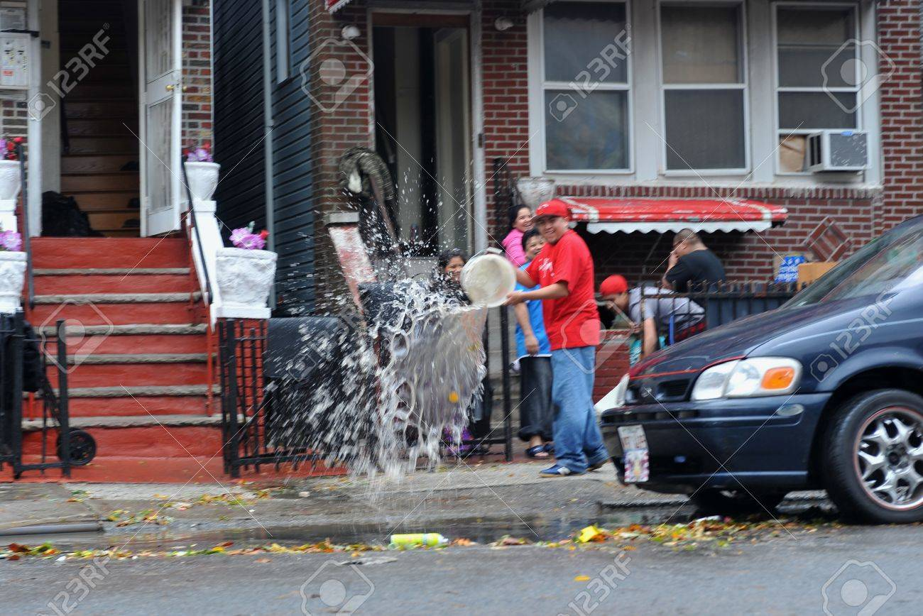 BROOKLYN, NY - OCTOBER 29: People pumping water out of building basement in the Sheapsheadbay neighborhood due to flooding from Hurricane Sandy in Brooklyn, New York, U.S., on Tuesday, October 30, 2012.   Stock Photo - 16558976