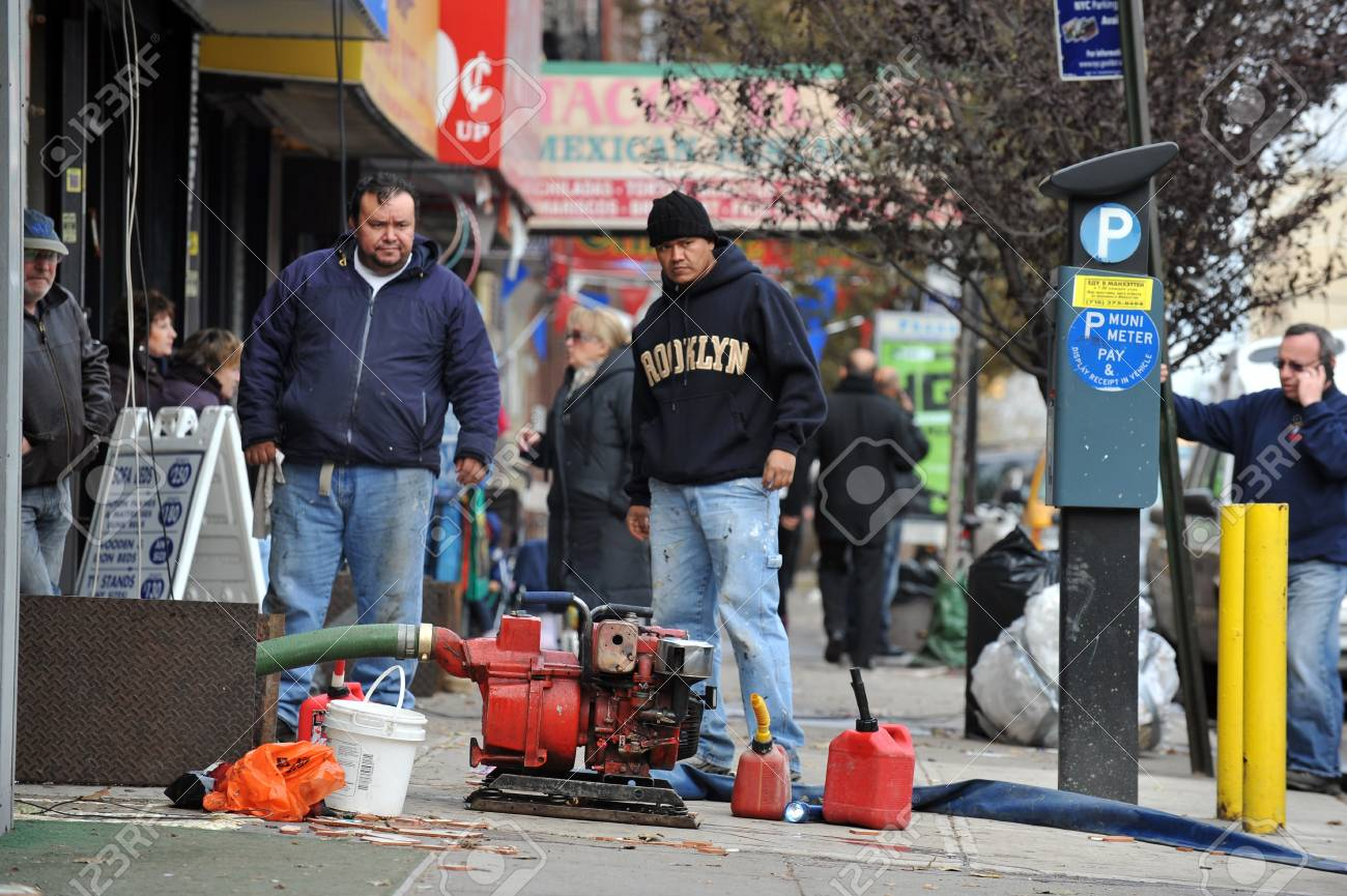 BROOKLYN, NY - NOVEMBER 01: Peoplepumping water out buildings at the Brighton Bwach neighborhood due to impact from Hurricane Sandy in Brooklyn, New York, U.S., on Thursday, November 01, 2012.   Stock Photo - 16559038