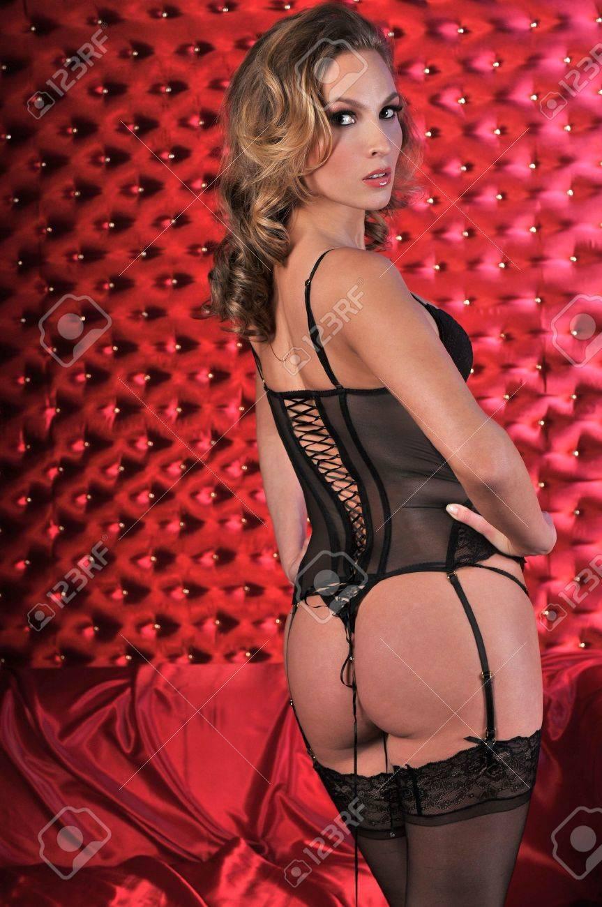 c920641f6 Sexy Lingerie Model posing pretty at studio vintage background set wearing  black corset