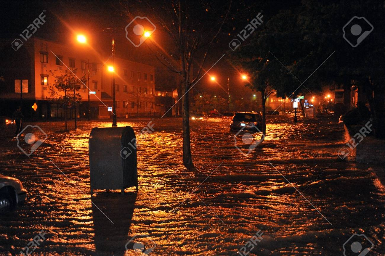 BROOKLYN, NY - OCTOBER 29: Flooded cars, caused by Hurricane Sandy, are seen on October 29, 2012, in the corner of Brigham street and  Emmons Avenue of Brooklyn NY, United States. Hurricane Sandy, which threatens 50 million people in the eastern third of  Stock Photo - 16816943