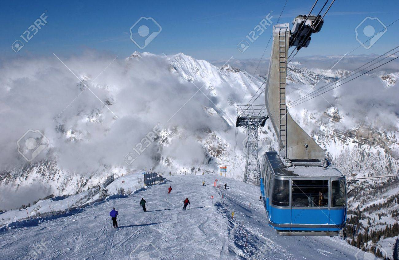 spectacular view to the mountains and blue ski tram at snowbird