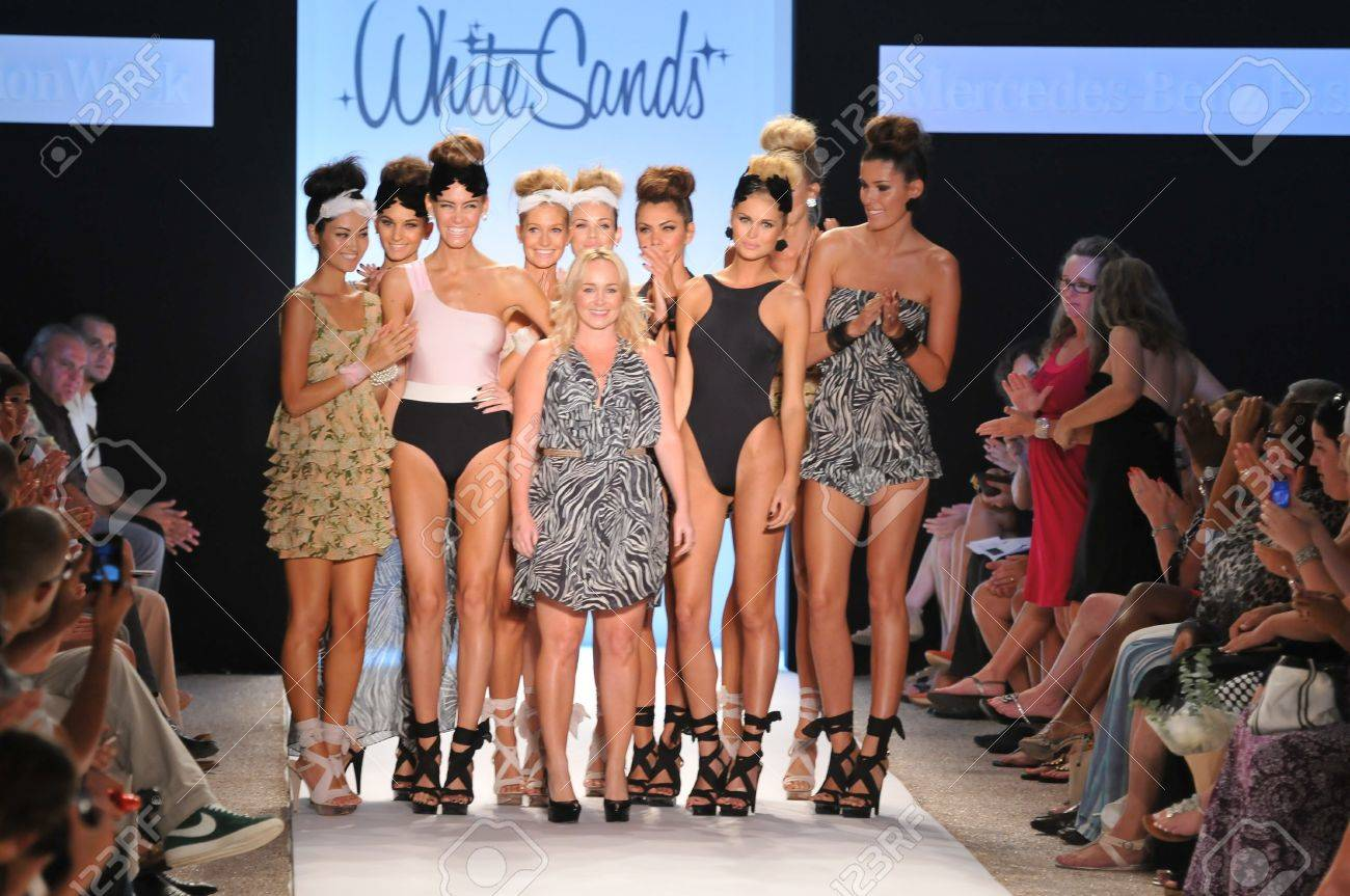 MIAMI - JULY 15: Designer Leah Madden (C) and models walks runway at the White Sands Australia Swimsuit Collection for Spring/ Summer 2012 during Mercedes-Benz Swim Fashion Week on July 15, 2011 in Miami, FL - 18536639