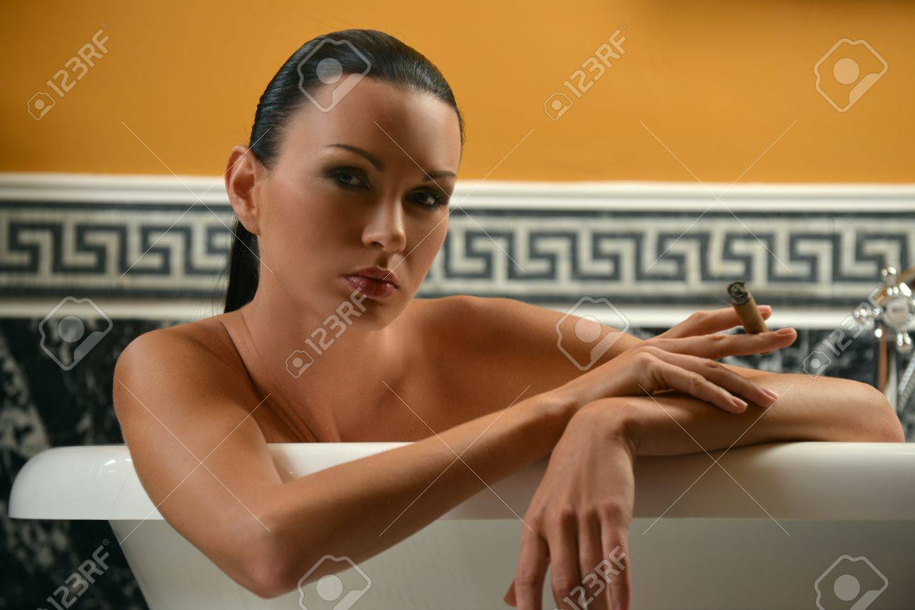 Portrait of sophisticated brunette woman in the bath holding cigar Stock Photo - 19671344
