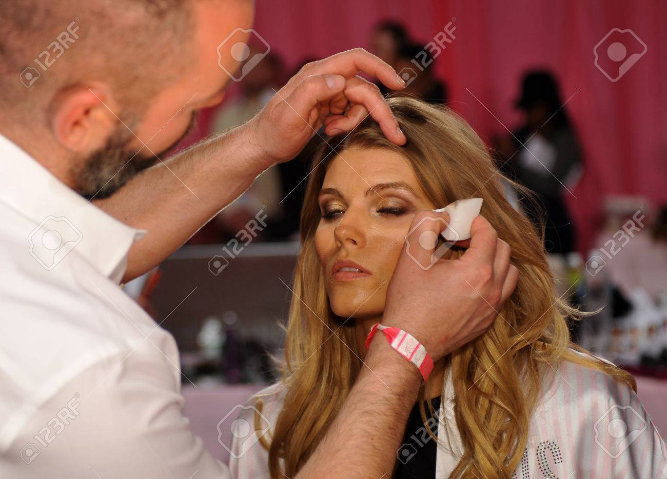 NEW YORK, NY - NOVEMBER 13: Lead Makeup Artist Dick Page applying make-up to model Maryna Linchuk at the 2013 Victoria's Secret Fashion Show hair and ...