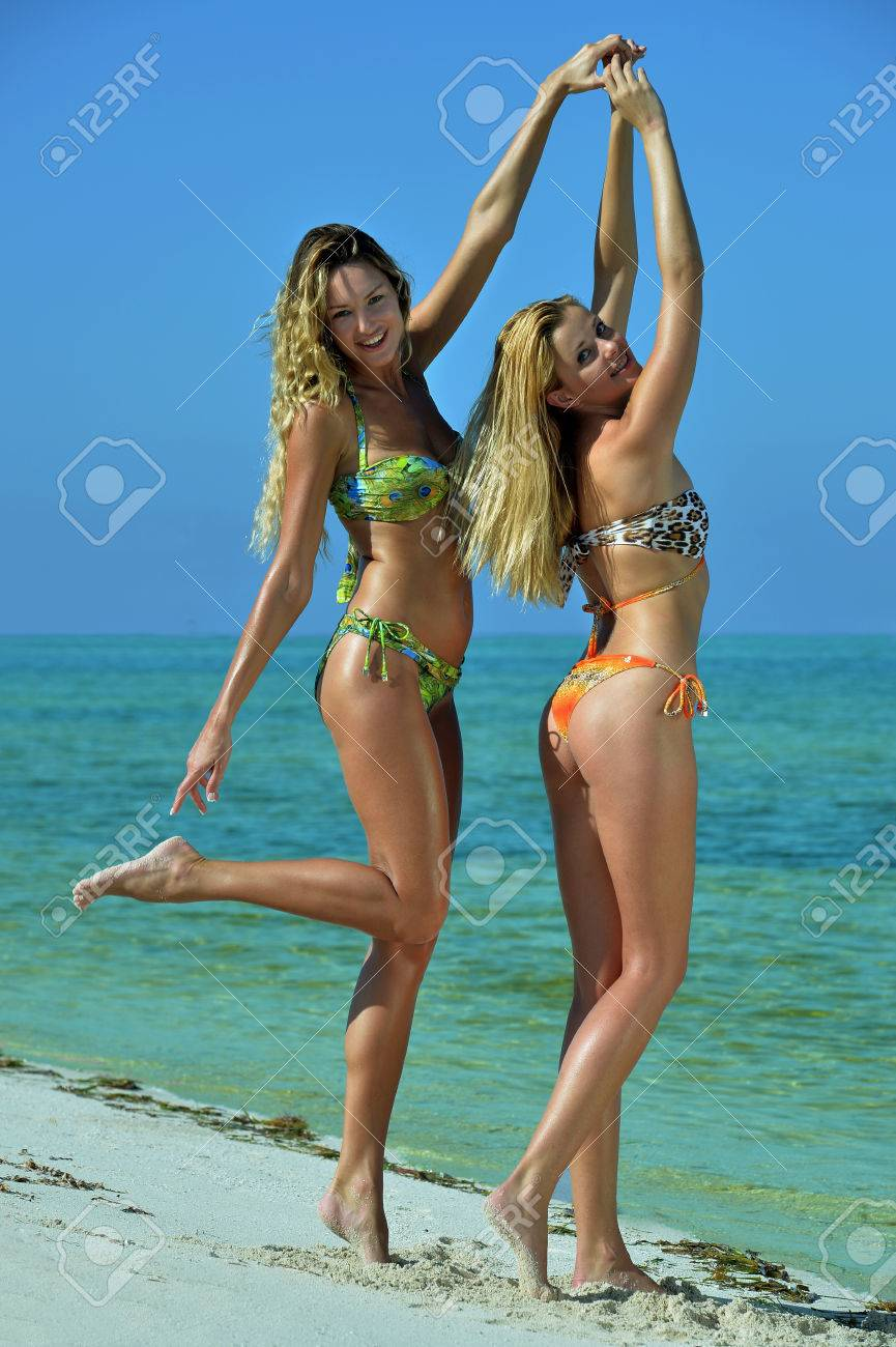 8414110ba74 Two bikini models posing sexy at tropical beach location Stock Photo -  24776353