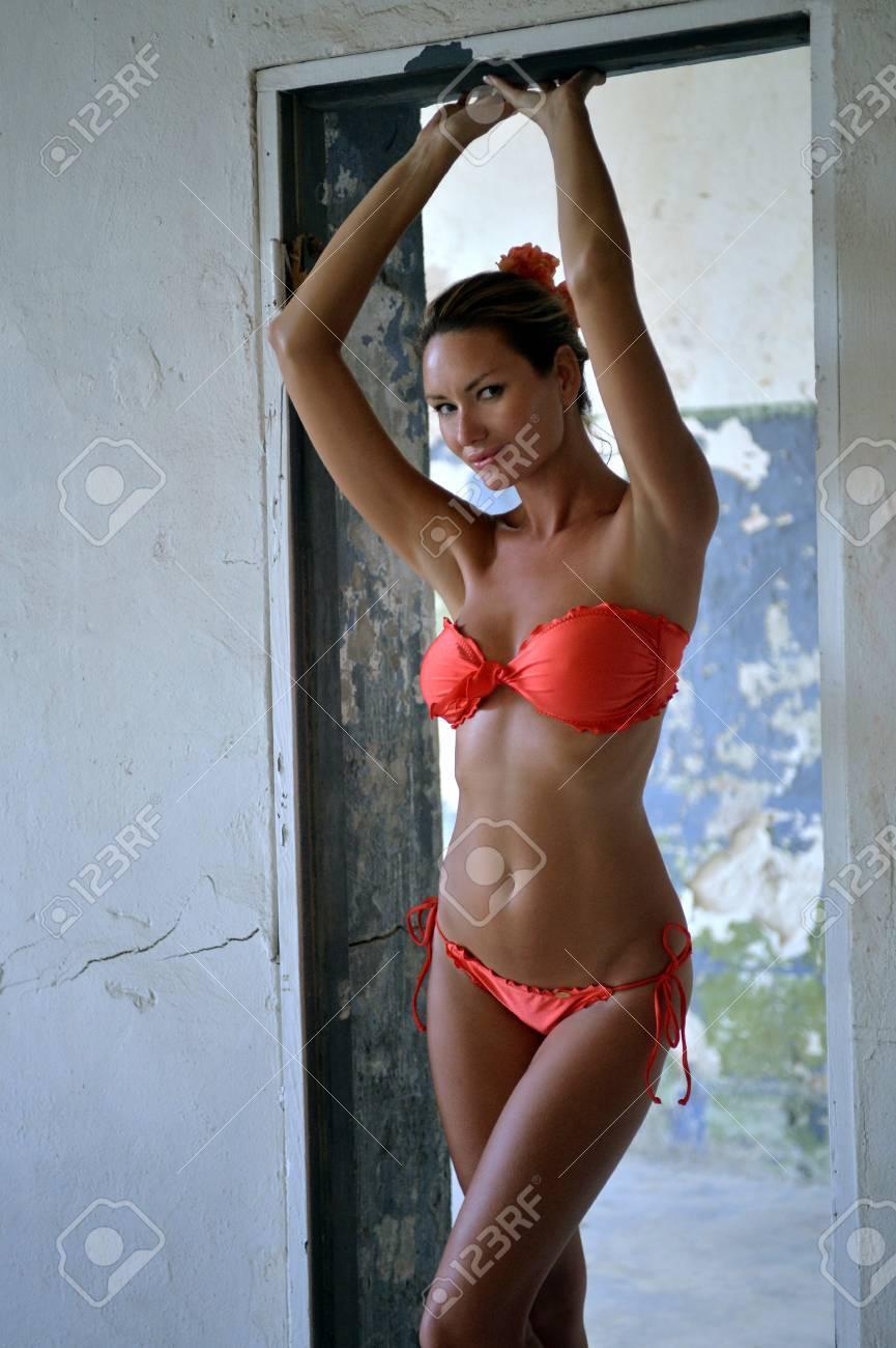 Seductive Bikini model posing sexy at old fort in Florida Stock Photo -  26557229