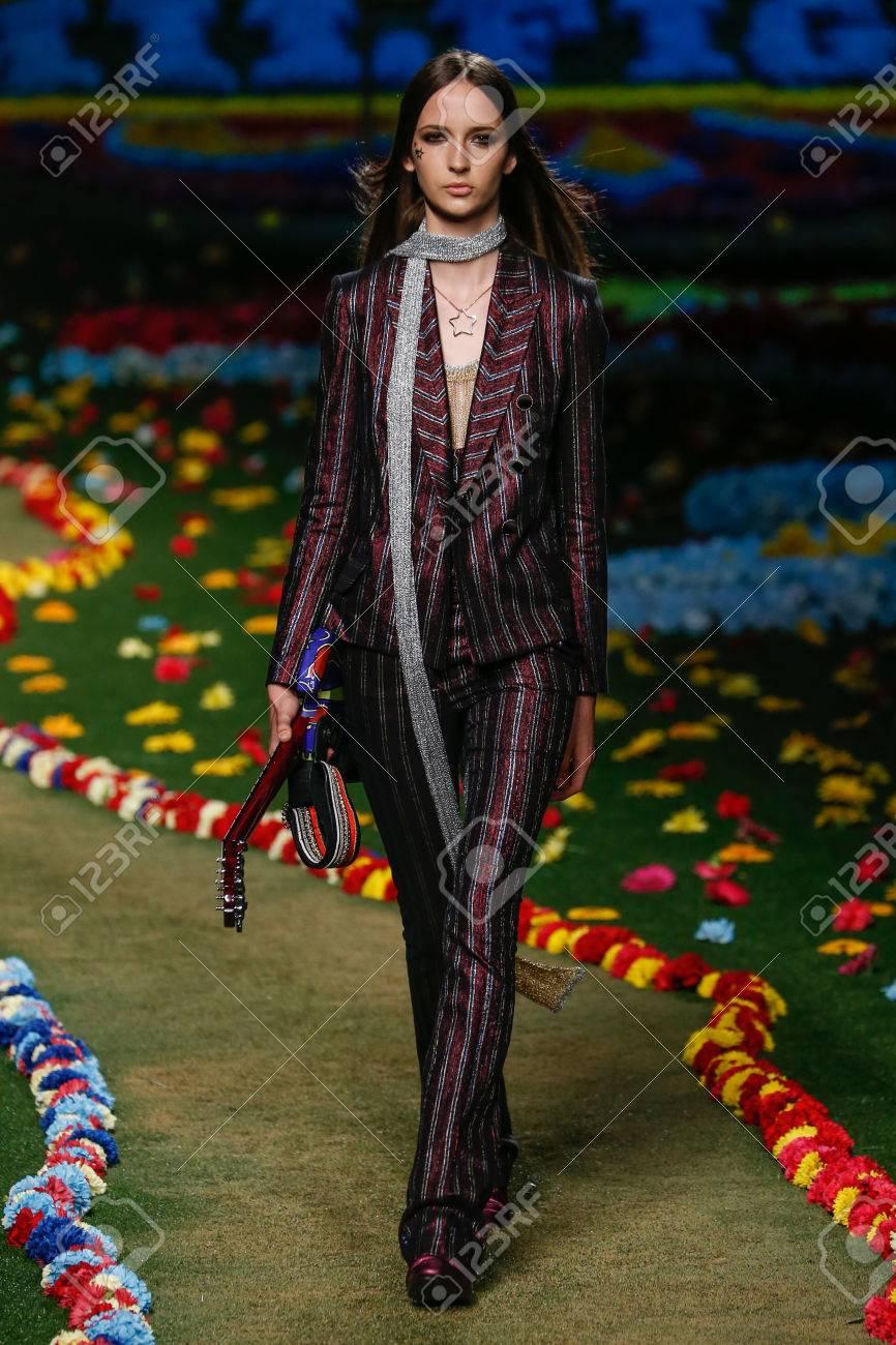 35946377 NEW YORK, NY - SEPTEMBER 08: A model walks the runway at Tommy Hilfiger