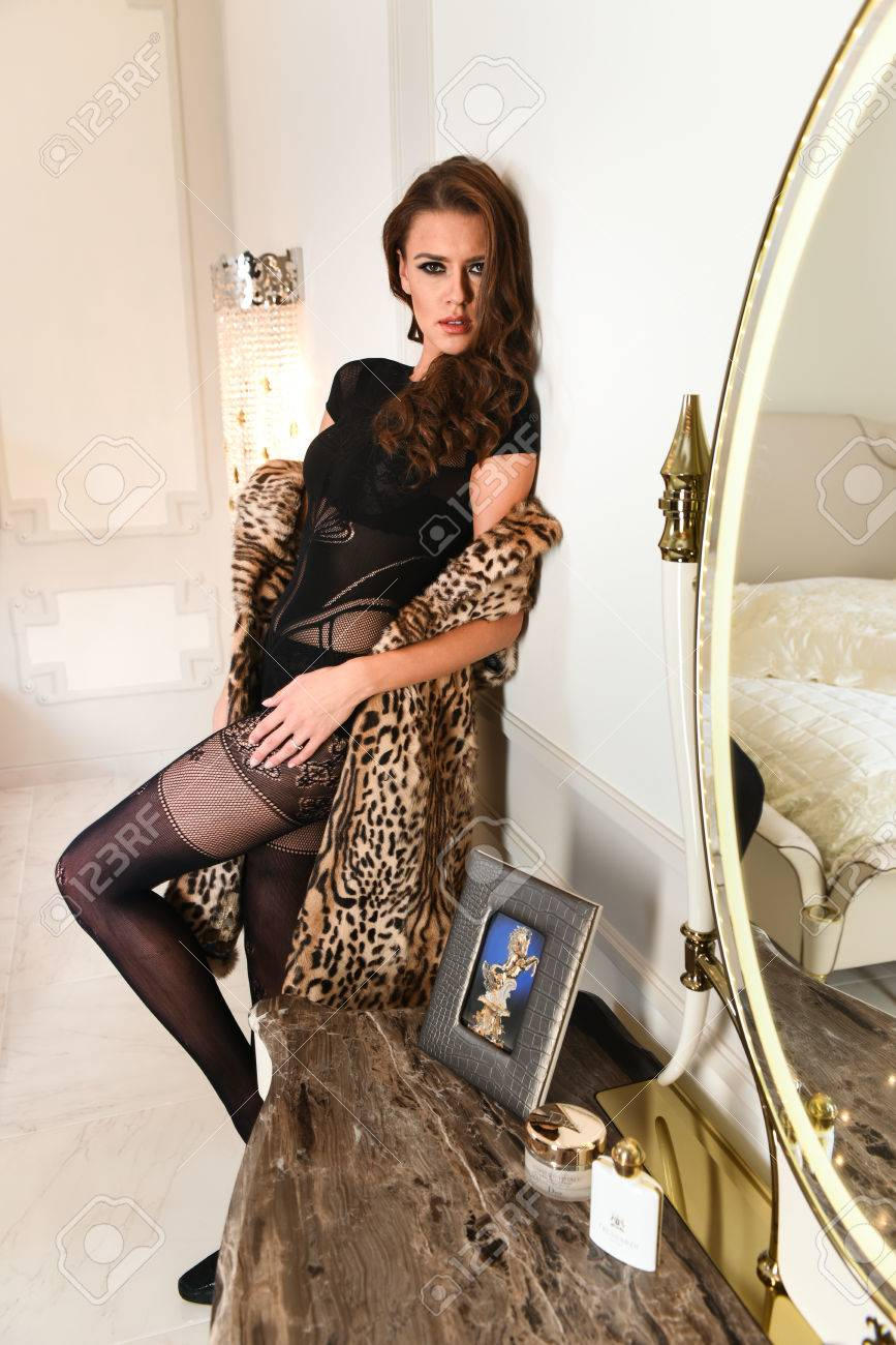 Fashion photo of sexy glamour woman with dark hair wearing elegant black  lingerie and fur coat 8b77bda6e