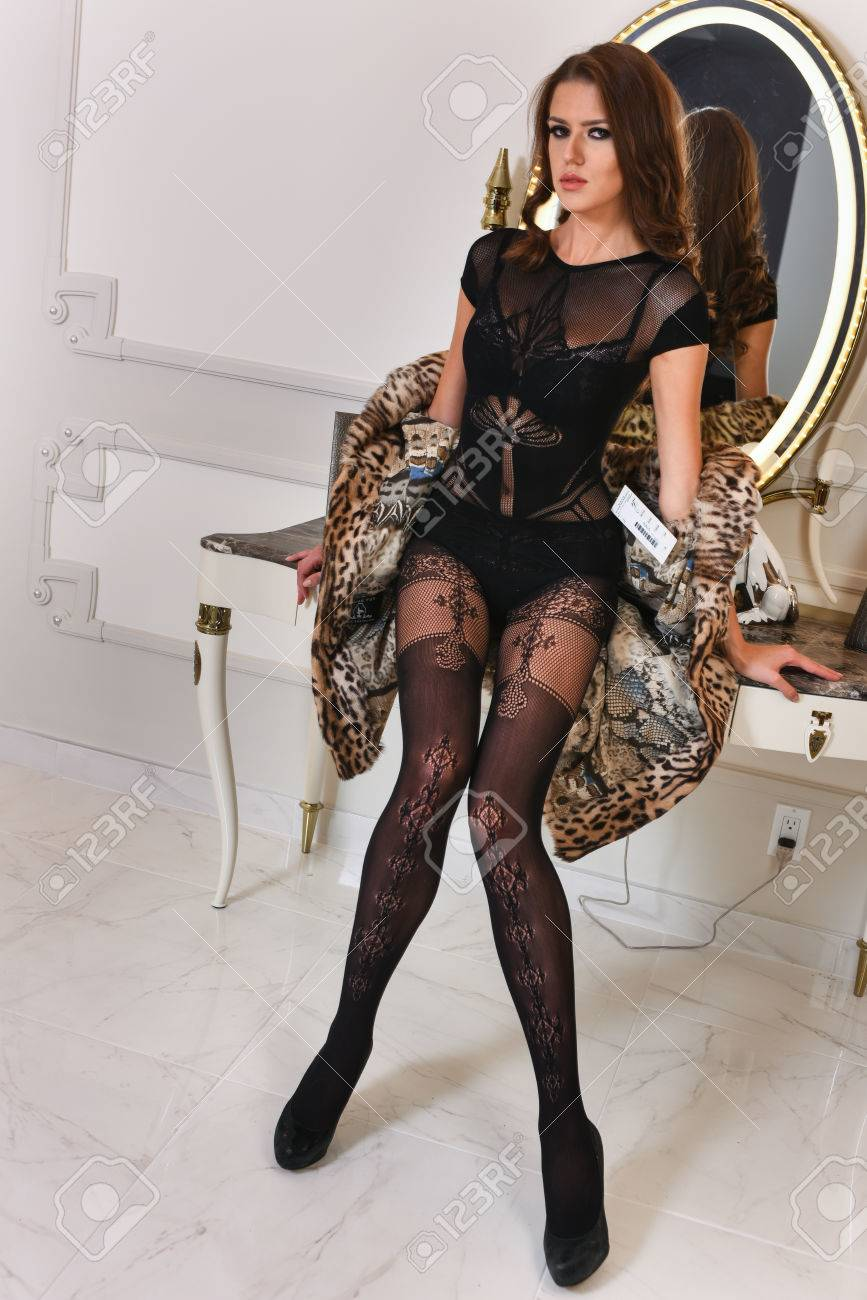 Picture of young beautiful woman in lace translucent lingerie bodysuit.  Sexy lady posing at modern 2c31a82dd
