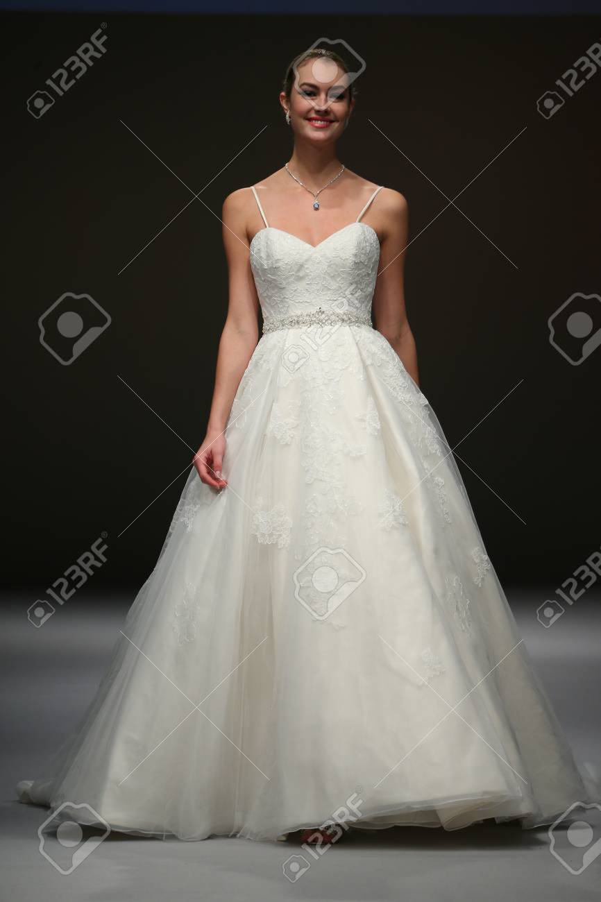 5f294ac4 NEW YORK, NY - OCTOBER 11: A model walks at Mon Cheri Bridal Fall