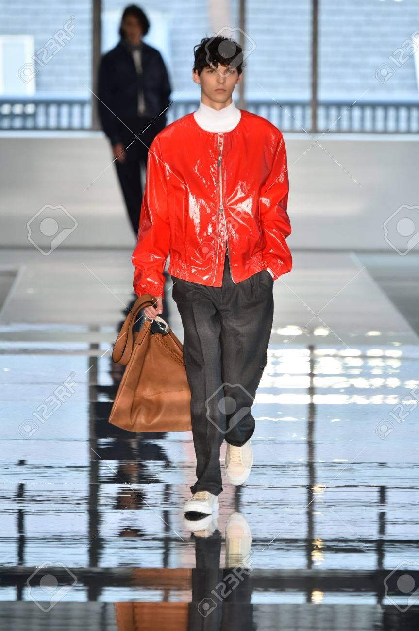 NEW YORK, NY - JULY 11: A model walks the runway at the BOSS