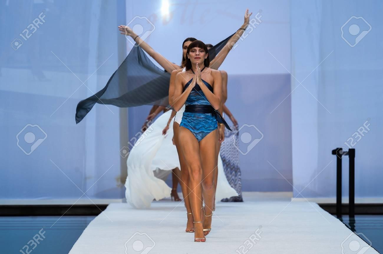 752ba95a26a2a MIAMI BEACH, FL - JULY 22: Models walk the runway finale at SWIMMIAMI Gottex