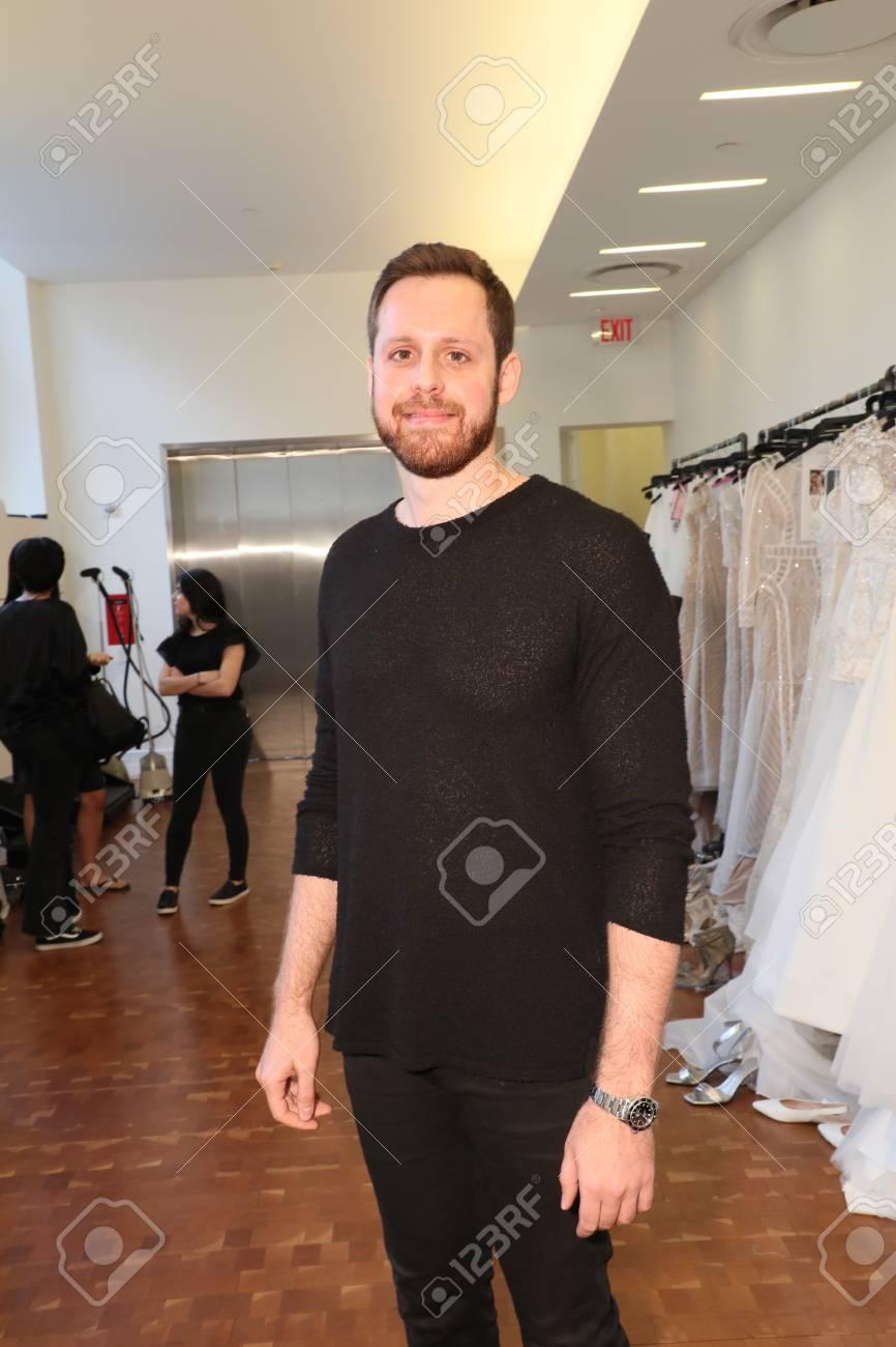 e1bcc42b37d3 NEW YORK, NY - APRIL 13: Designer Justin Alexander posing backstage before  the Justin