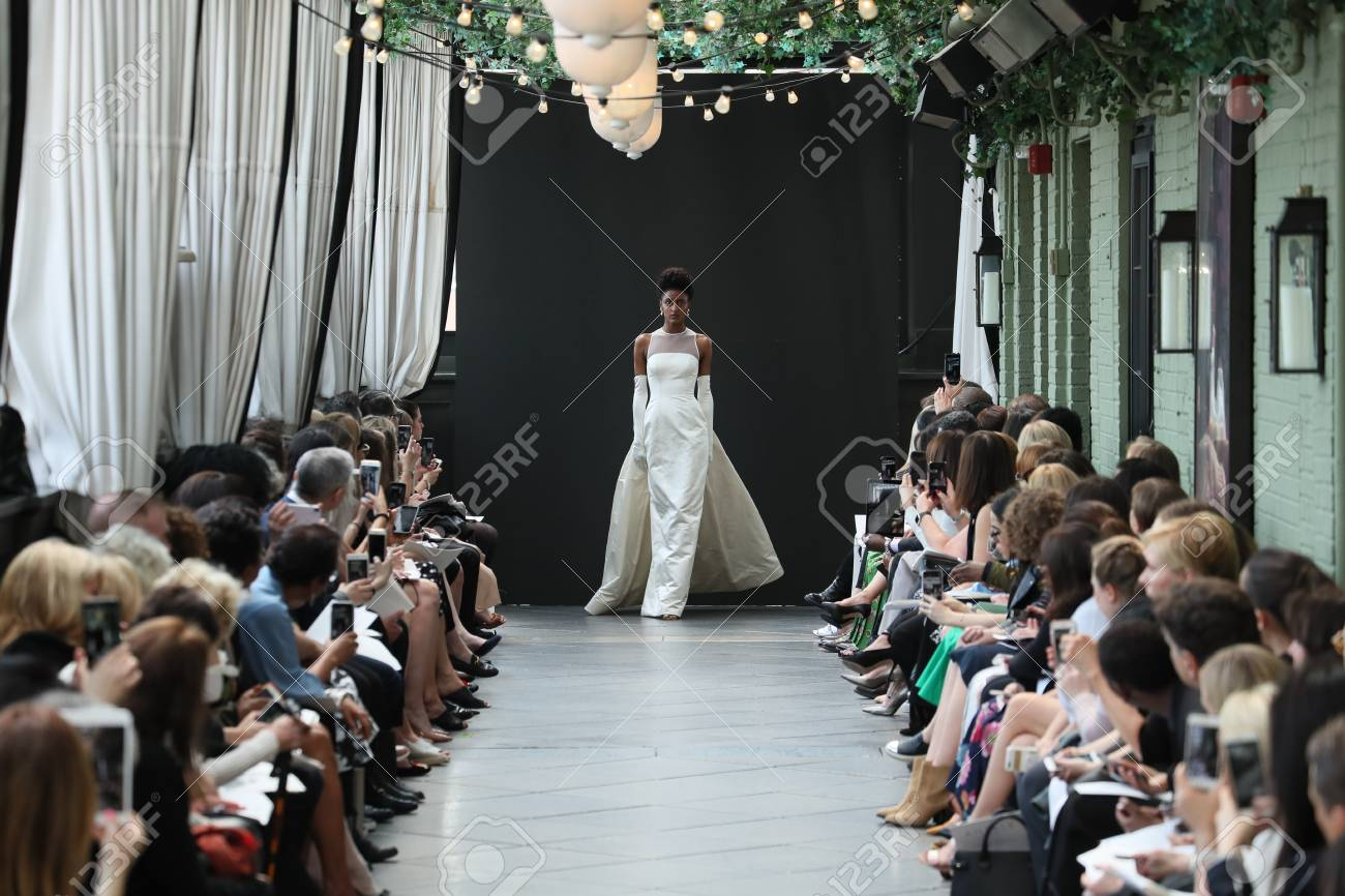 NEW YORK, NY - APRIL 13: A model walks the runway at the Amsale