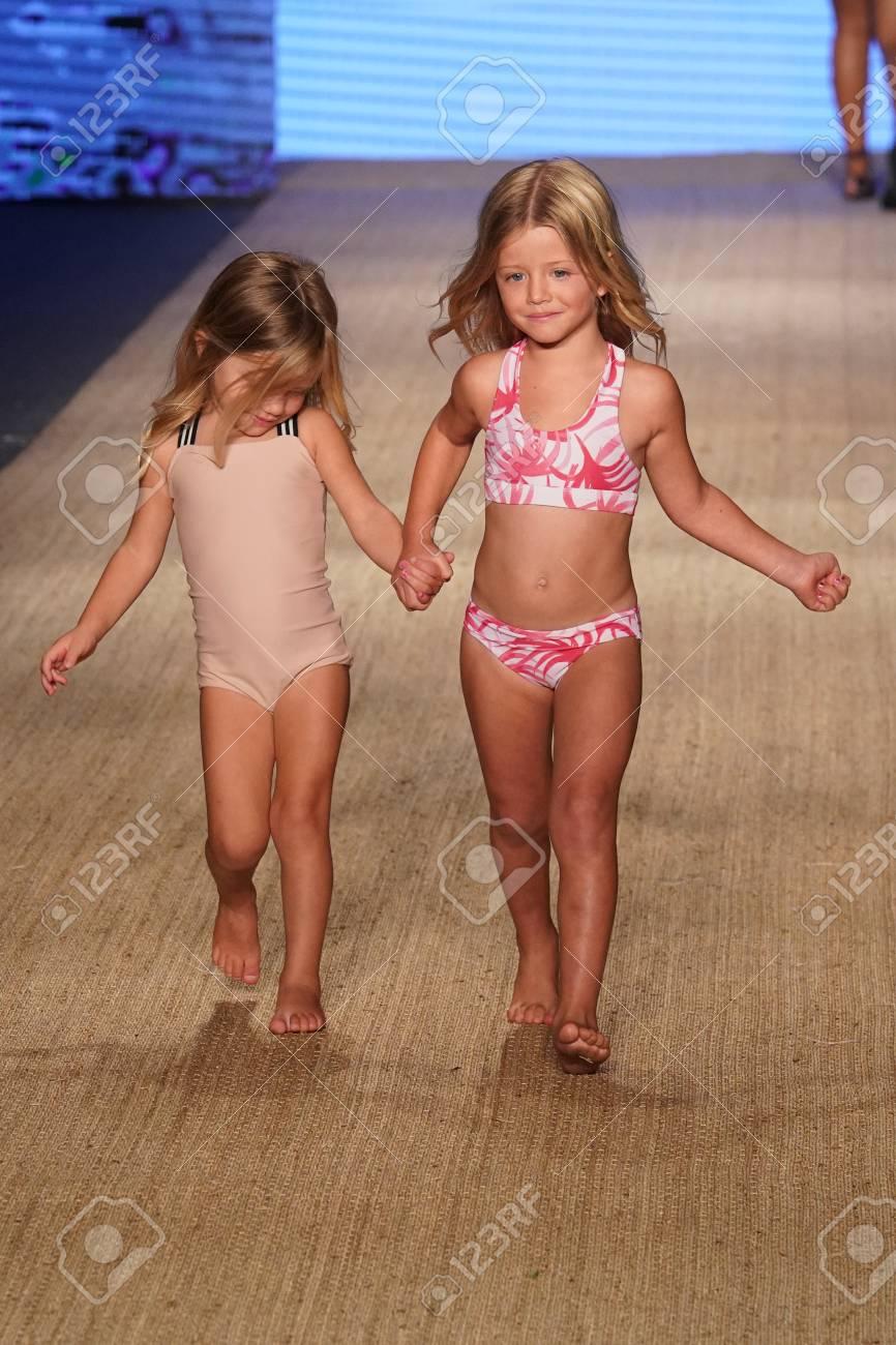 9caa66a698 MIAMI BEACH, FL - JULY 13: A model walks the runway for MIKOH Resort