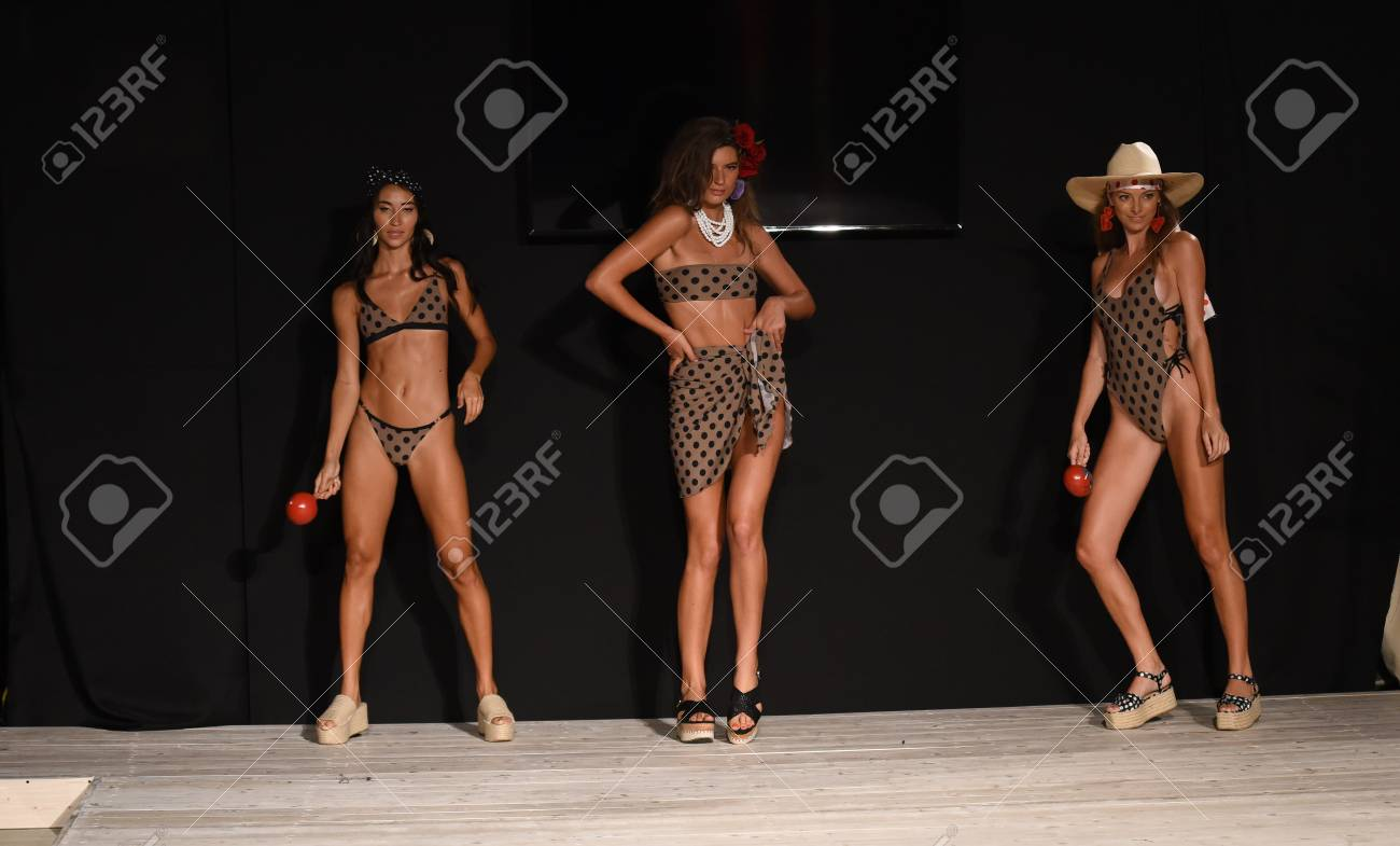 MIAMI BEACH, FL - JULY 13: Models walk the runway for ISHINE365