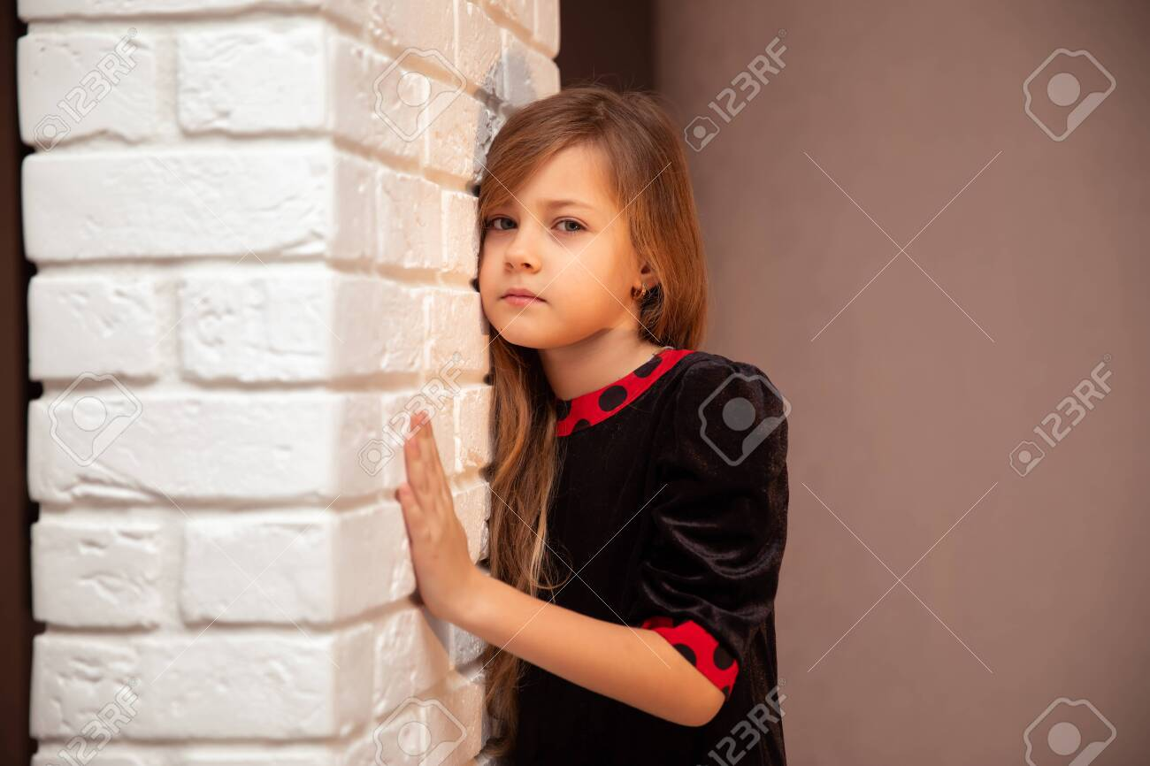Beautiful Cute Girl With Long Hair In Black And Red Dress At Stock Photo Picture And Royalty Free Image Image 141067691