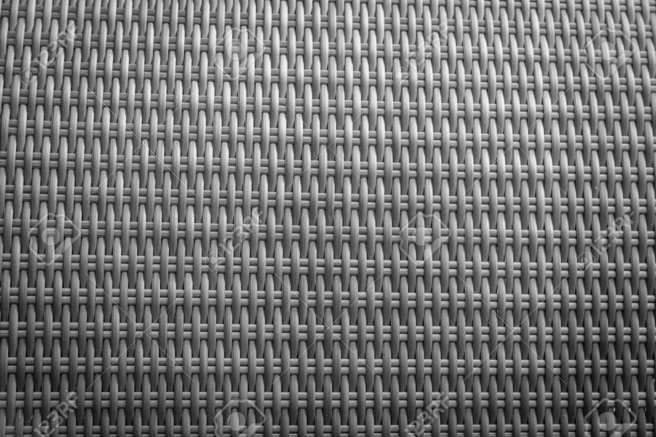 Rotin synthétique texture tissage utilisé sur les meubles de jardin en  plein air.