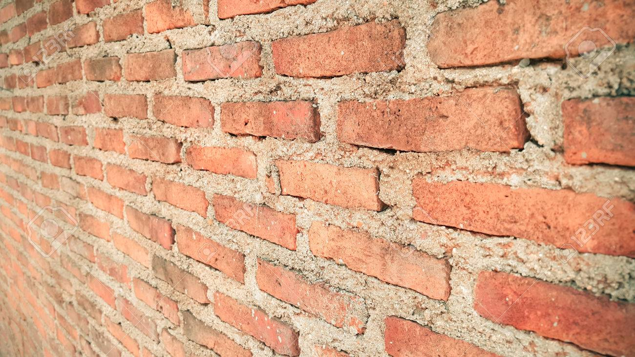 Side View Of Old Orange Vintage Brick Wall Background Stock Photo
