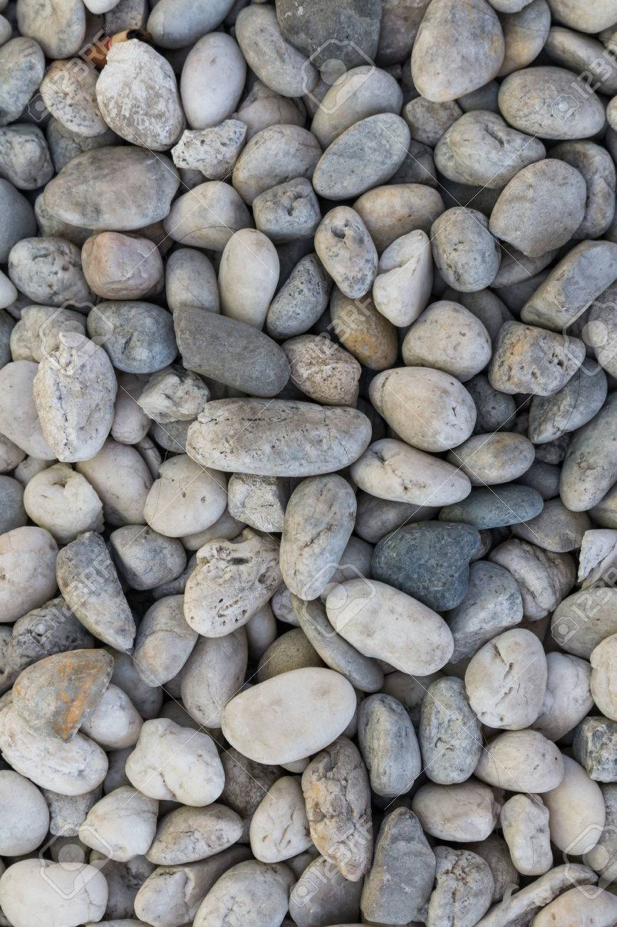 Smooth shaped white stones surface texture background stock photo - White River Stone Texture Background Stock Photo 43937392