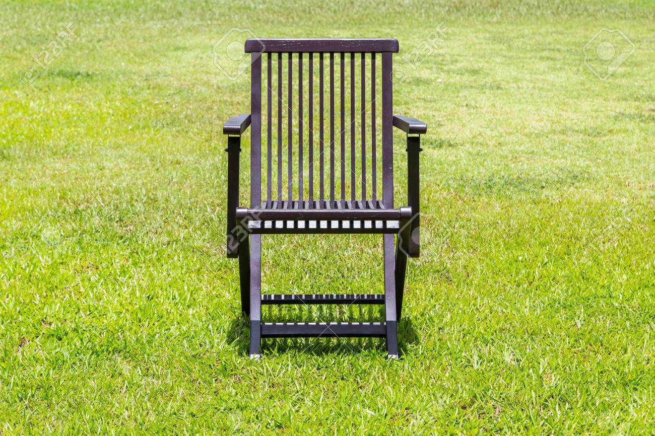 Black Wooden Chairs On The Lawn Green Nature Background Stock Photo    44302463