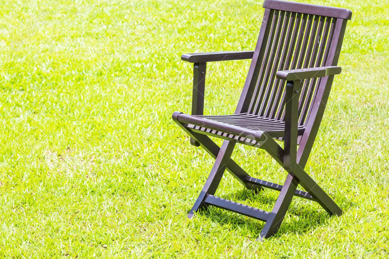 Black Wooden Chairs On The Lawn Green Nature Background Stock Photo    44302791