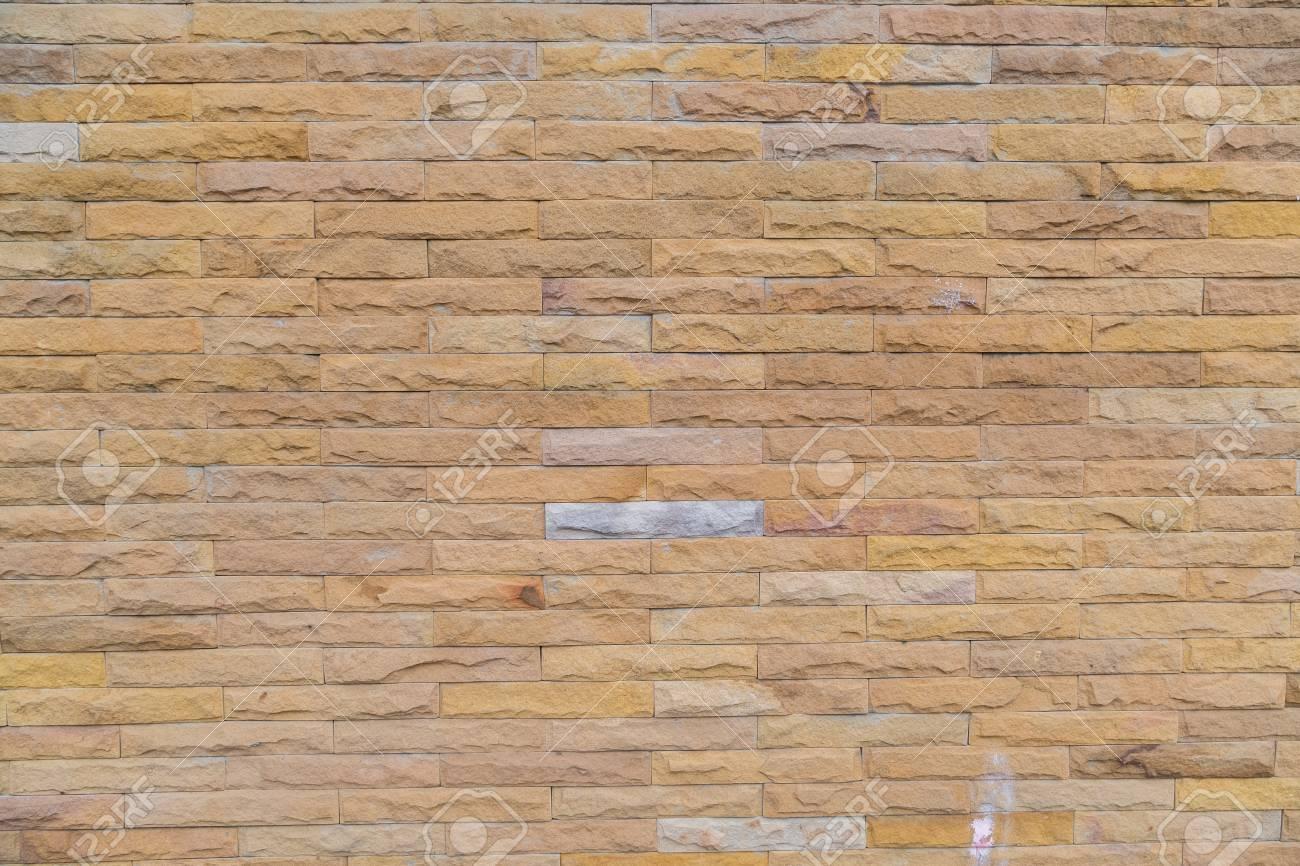 Muro Fatto In Pietra gialla pietra muro fatto con blocchi di pietra utilizzare per lo sfondo