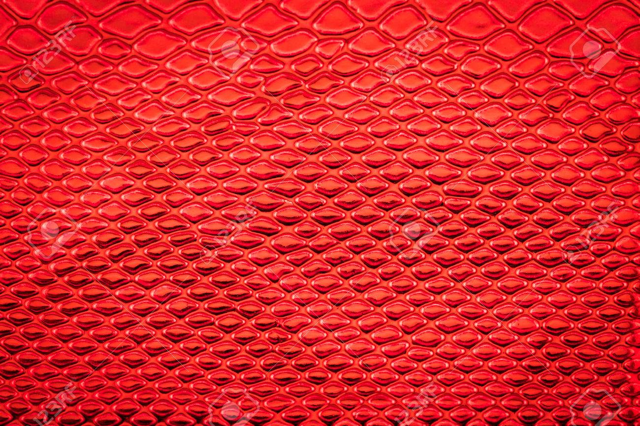 Red Exotic Snake Skin Pattern As A Wallpaper Stock Photo