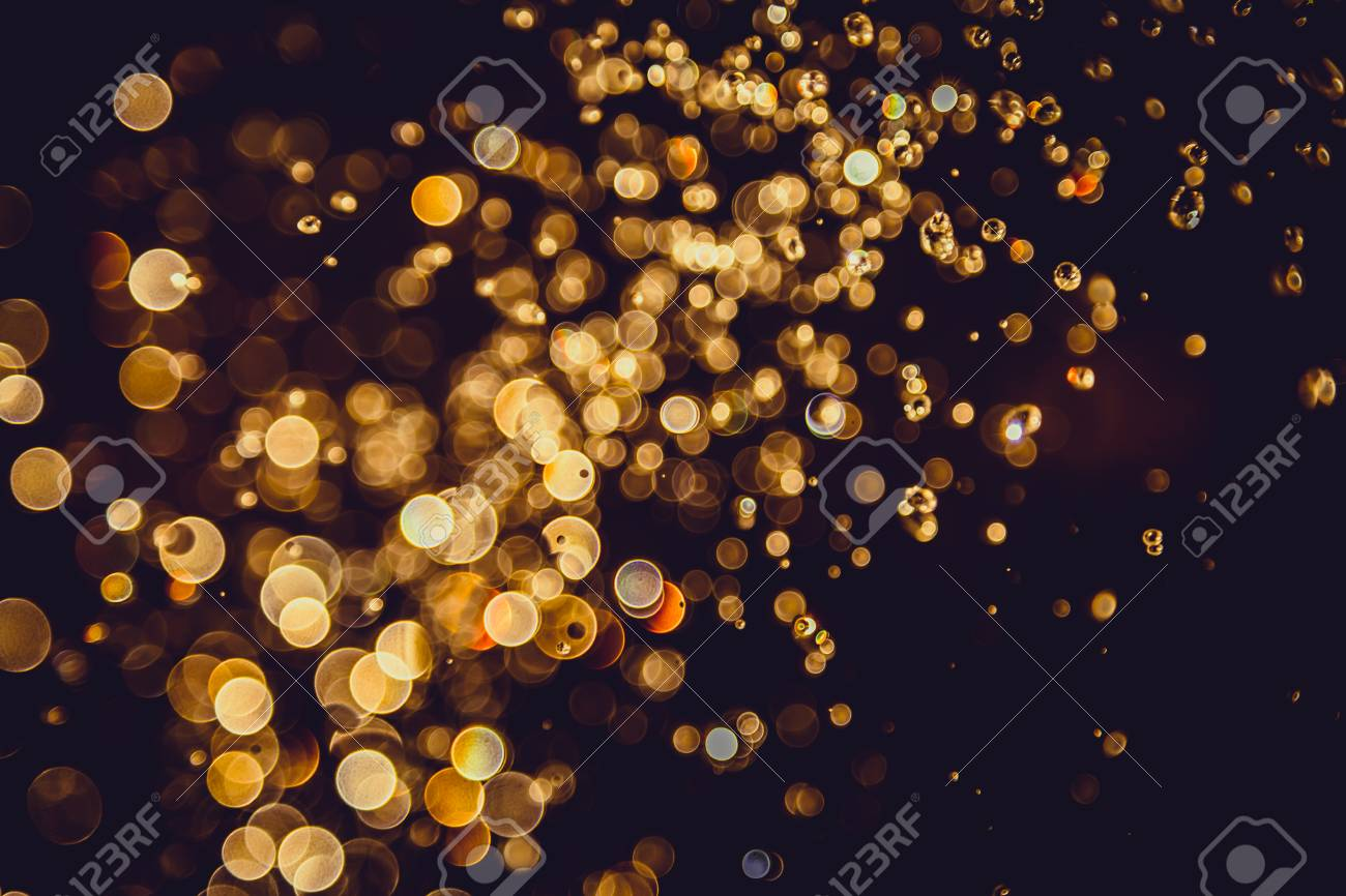 Defocus Bokeh Glitter Gold Vintage Lights Dark Background Stock Photo Picture And Royalty Free Image Image 76389967