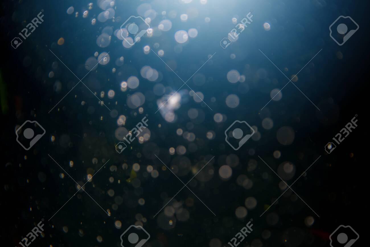 Abstract black defocus bokeh glitter vintage lights with black background - 129615061