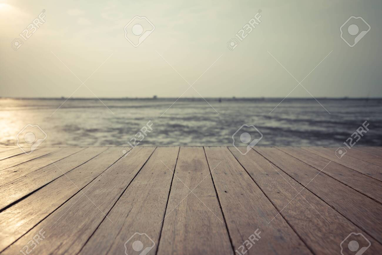 Vintage wood floor extends into the sea when the water drops - 140101688