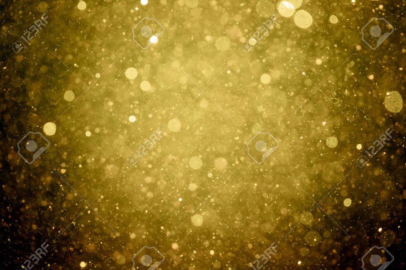 Beautiful gold glitter vintage lights background - 143174775
