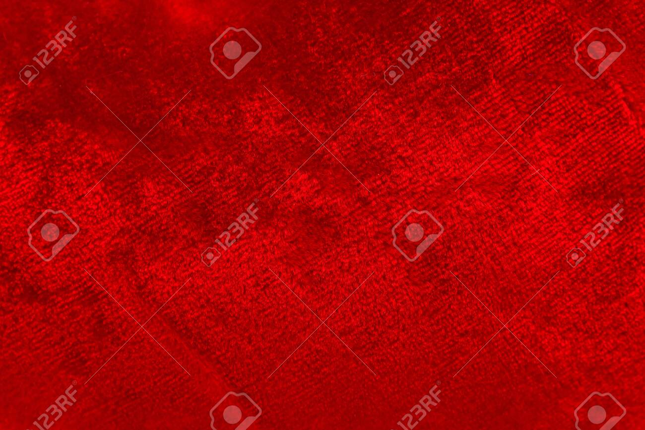 Red luxury wool natural fluffy fur wool skin texture close-up use for background and wallpaper - 145042606